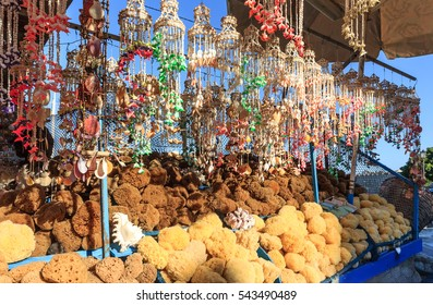 Natural Sea Sponges and Shells souvenir stand at a Greek harbour