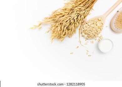 Natural skin cleansing product for body detox. Oat flakes, cream, oat milk, body scrub brush, white table, home spa.