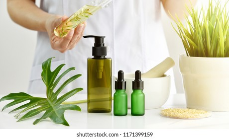 Natural skincare cosmetics research and development concept, Doctor formulating new beauty products from natural, Pharmacist mixing extract essence substance in test tube with container package