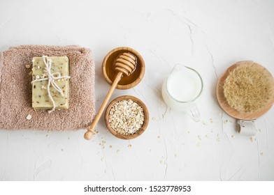 Natural skincare with natural soap, milk, oats and honey soap, homemade beauty products, home spa and beauty care concept, top view