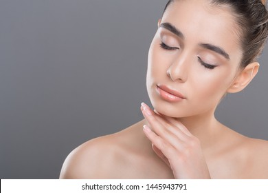 Natural skincare. Young woman caressing her smooth soft skin with closed eyes, copy space