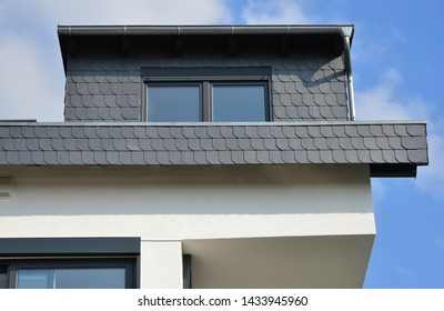 Natural Slate plated Dormer Window on a tiled Roof