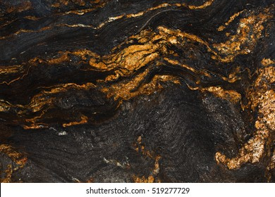 Natural slate with shades of gold and black. High resolution photo
