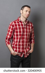 natural smile - relaxed smiling middle age man wearing casual red checked shirt with beard and goatee for comfort,studio shot