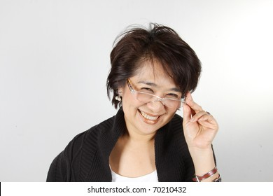 Natural smily woman, Asian Woman with natural smily face wearing glasses.