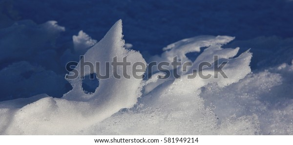 Natural snow sculpture. Snow shaped by wind and weather.