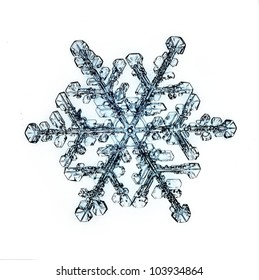 natural snowflake isolated on a white background a strong increase