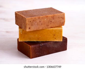 Natural soap bars on white wooden background