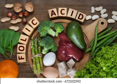 Natural sources of folic acid as liver, asparagus, broccoli, eggs, salad, avocado, yeast, nuts, spinach, orange and beans