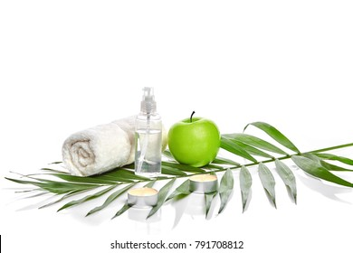 Natural spa beauty treatment cleansing products with apple on white background.