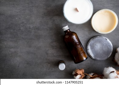 Natural spa cosmetic products from above on gray concrete table. Beauty blogger, salon treatments, minimalism concept