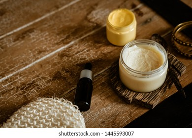 Natural SPA cosmetics on wooden table from above. Warm toned filter. Beauty rituals, skincare, body detoxing, beauty blogger concept