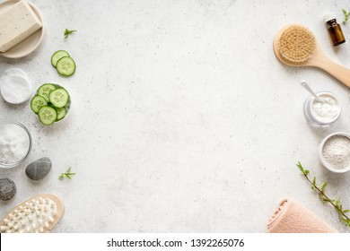 Natural Spa with cucumbers, copy space, flat lay. Organic spa cosmetic products and natural skincare concept on white.