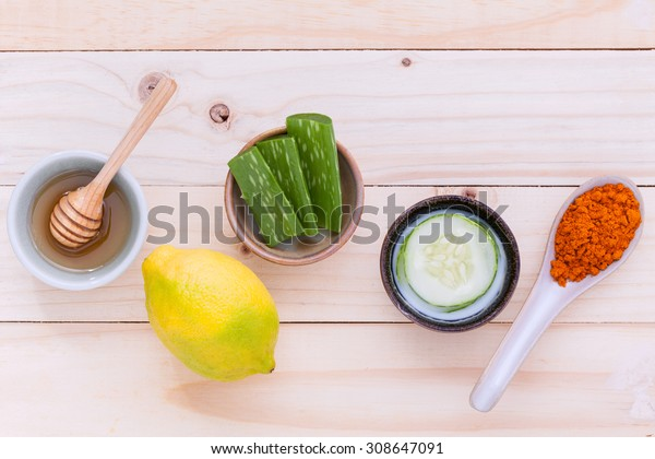 Natural Spa Ingredients homemade facial masks and natural ingredients for skin care on wooden table.