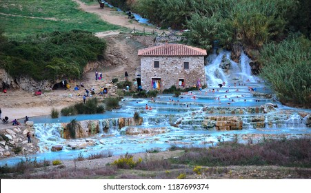Natural spa with waterfalls and hot springs at Saturnia thermal baths, Grosseto, Tuscany, Italy. People unrecognizable. Natural Spas Saturnia. Autumn, October.