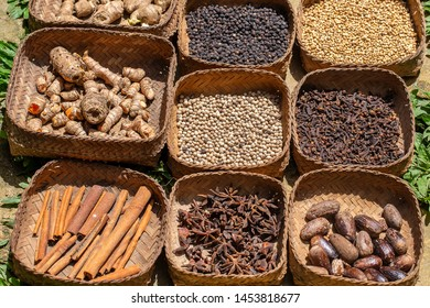 Natural spice in local market on tropical island Bali, Indonesia. Black and white pepper, ginger, nutmeg, cinnamon sticks, star anise, dry cloves, close up