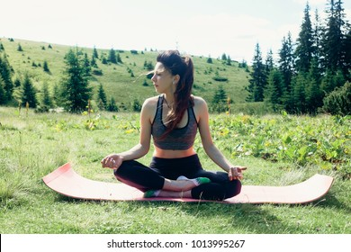 natural, sport, health, people, lifestyle concept - Healthy young independent female yoga practitioner, practicing meditation and poses mountain beautiful serene view overlooking the pureness