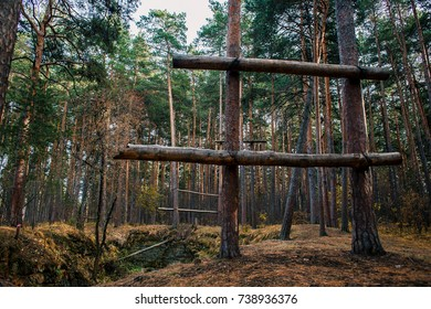 A natural sports trainer created by people's hands. Large logs are tied to trees