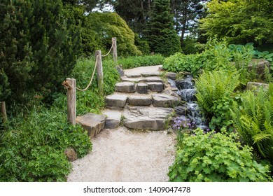 Natural stairs made of stone in a park or garden. Arrangement of nature