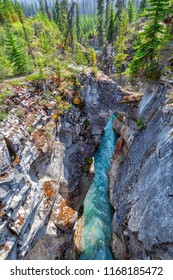 Natural stone bridge spans the deep and narrow Marble Canyon with turquoise colored waters from Tokumm Creek flowing below at Kootenay National Park in British Columbia, Canada, near Banff.
