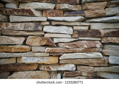 Natural stone flagstone, laid in uneven rows. Background of the flagstone