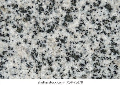 Natural stone grey granite background. Facing material granite texture. Grey granitic background texture. Hard gray granite rock texture. Grey granite stone background texture. Grey granitic surface.