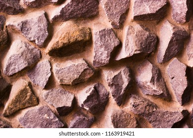 Natural stone laid out in the wall