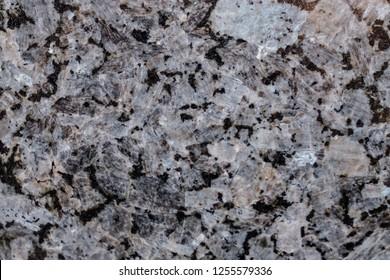 Natural stone. Pink granite. Black. Grey. Facing material. Bright hard granite rock texture. Granite tone background texture. Granitic untreated surface. Texture