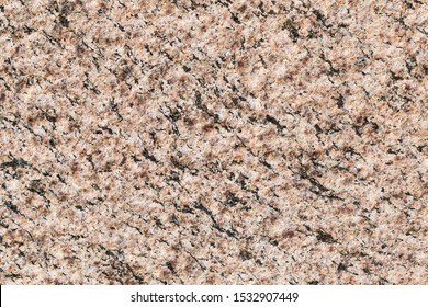 Natural stone red granite texture background. Granite Texture, Red Base with Black and Gray Spots. Closeup seamless pattern and texture of red granite
