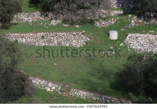 Natural Stone Retaining Wall On Slope Stock Photo (Edit Now