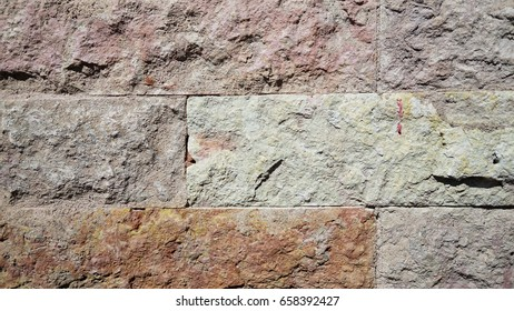 Natural stone tiles. Colors of tiles are gray, brown and burgundy.