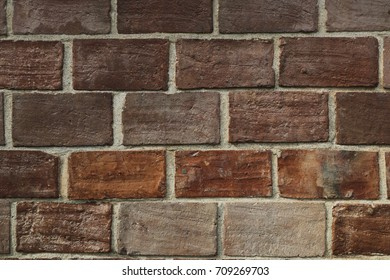 Natural stone wall texture  for background and wallpaper, Decorative wall with beautiful rough brown bricks .
