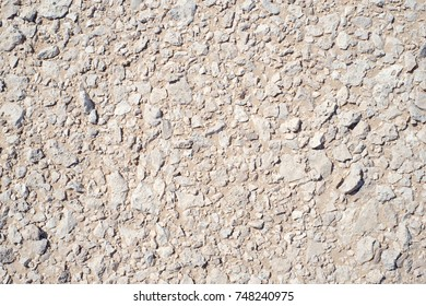 Natural stones pile on sand texture background