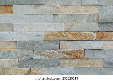 Natural stones of a stone wall