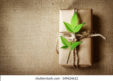Natural style handcrafted gift box with rustic twine on burlap with copy space
