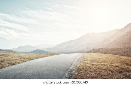 Natural summer landscape with countryside road to horizon