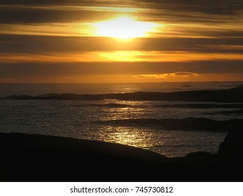 Natural Sunset Over Sea. Bright Dramatic Sky With Stripes Of Clouds. Sun Over Ocean Horizon. Larvik, Norway.