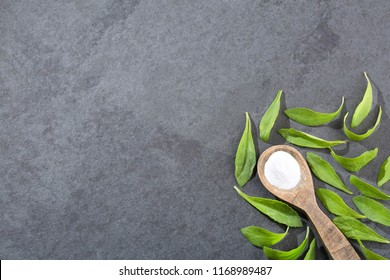 Natural sweetener in powder from stevia plant - Stevia rebaudiana. Top view