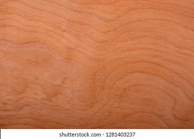 Natural swirled grain cherry unfinished wood chip color sample.