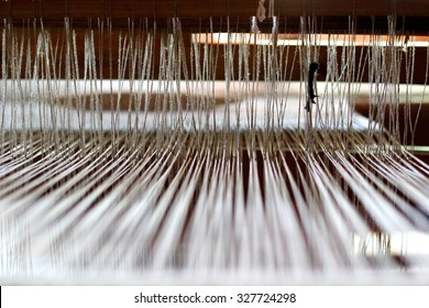 Natural textile weaving, strained threads