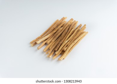 Natural toothbrush Miswak (Kayu Sugi) on white background with selective focus. It is a teeth cleaning twig made from the Salvadora persica tree and also know as miswaak, siwak, Sugi or sewak