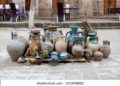 Natural traditional clay pottery beautiful old kitchen appliances, dishes, jugs, vases, pots, mugs. The background.