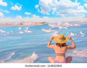 Natural travertine pools and terraces in Pamukkale. Cotton castle with beautiful girl - Southwestern Turkey,