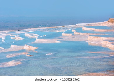 Natural travertine pools and terraces in Pamukkale -  Cotton castle in southwestern Turkey,