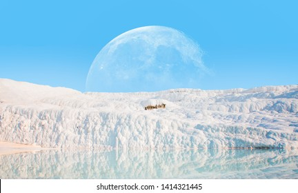 """Natural travertine pools and terraces in Pamukkale with full moon - Cotton castle in southwestern Turkey """"Elements of this image furnished by NASA """""""