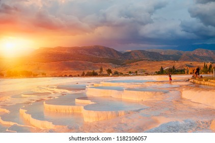 Natural travertine pools and terraces at sunrise - Pamukkale  (Cotton castle) in southwestern Turkey,