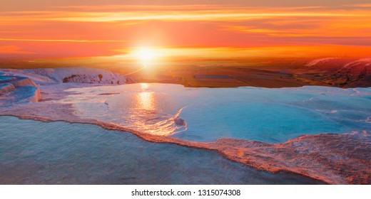 Natural travertine pools and terraces at sunrise - Pamukkale (Cotton castle) in southwestern Turkey