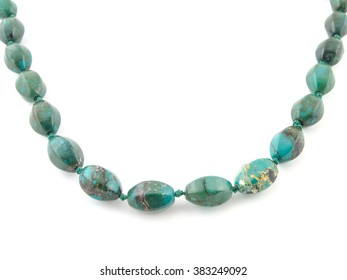 natural turquoise beads on a white background.