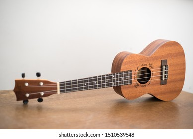 Natural ukulele for children and adults. 4 string instrument.