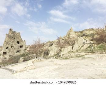 Natural valley with volcanic tuff stone rocks in the evening. Goreme, Cappadocia, Central Anatolia region of Turkey. Popular tourist destination in Turkey for trekking.